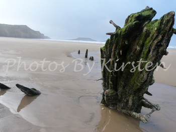 A Stock Photo of a Beach with a Ship Wreck