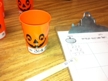 Addition with regrouping Pumpkin Math Center