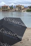 Black umbrella on beach