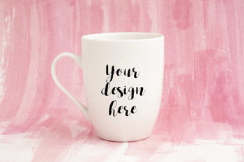 Blank cup of coffee white mug mock up pink painted background stock photo