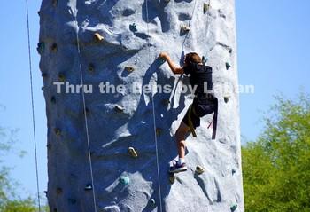 Boy Climbing on Rock Wall Stock Photo #99