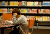 Boy Reading a Book at the Library Stock Photo #258