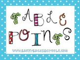 Bright Polka Dot Table Signs with Owl {A, E, I, O, U} using clothespins