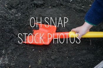 Child Digging In The Dirt Stock Photo