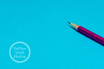 Dollar Stock Photo 212 Pink Glitter Pencil on Blue