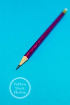 Dollar Stock Photo 213 Pink Glitter Pencil on Blue