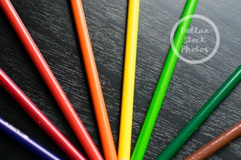 Dollar Stock Photo 278 Colored Pencils on Black Table