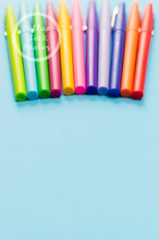 Dollar Stock Photo 281 Colorful Pens on Teal Tall