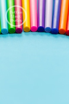 Dollar Stock Photo 282 Colorful Pens on Teal Tall