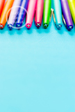 Dollar Stock Photo 283 Colorful Pens on Teal Tall