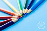 Dollar Stock Photo 68 Colored Pencils on Blue