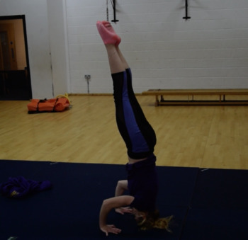 How to teach a gymnastics headstand?