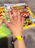 Learning with Beads: Retelling Bracelets