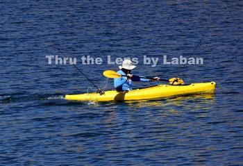 Man Kayaking and Fishing Stock Photo #101