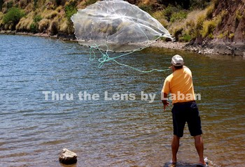 Man Throwing a Fishing Net Stock Photos #189 and #190