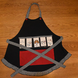 Show and Tell Apron (black with houndstooth trim and red pocket)