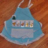 Show and Tell Apron (light blue apron with gray circle trim)