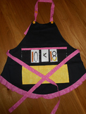 Show and Tell Apron (black with yellow pocket/pink polka trim)