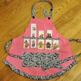 Show and Tell Apron (pink apron with black and white paisley trim)