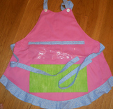 Show and Tell Apron (pink with green pocket/blue polka ruffle)