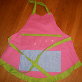 Show and Tell Apron (pink with green ruffle/blue polka pocket)
