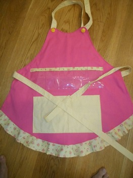 Show and Tell Apron (pink with yellow floral ruffle and yellow polka pocket)