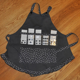 Show and Tell Apron (slate apron with black and gray floral trim)