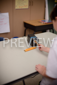 Stock Photo: Student Sharpening Pencils (Helping) -Persona