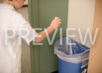 Stock Photo: Student Throwing Away Trash-Personal & Commer