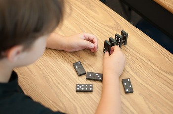 Stock Photo: Student with Dominos #3 -Personal & Commercial Use