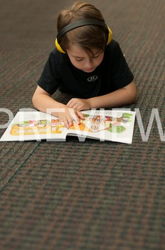 Stock Photo: Student Reading with Headphones #13-Personal & Commercial Use