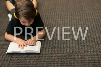 Stock Photo: Student Reading with Headphones #14-Personal & Commercial Use