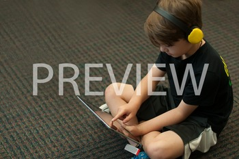 Stock Photo: Student Listening on an iPad #3-Personal & Commercial Use