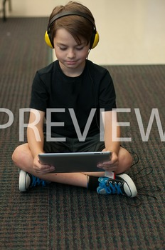 Stock Photo: Student Listening on an iPad #4-Personal & Commercial Use