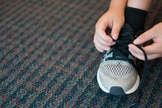 Stock Photo: Tying Shoes -Personal & Commercial Use