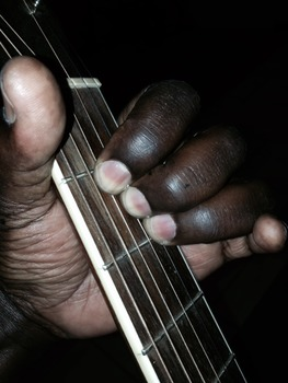 The A B C of playing a guitar.