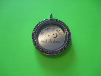 """To teach a child is to touch the future"" PEEKABOO PENDANT locket"