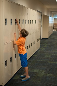 Stock Photo: Student Reaching on Tiptoes #1 -Personal & Commercial Use
