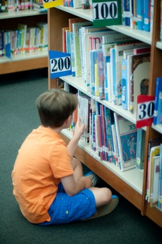 Stock Photo: Student Reading in the Library #4 -Personal & Commercial Use
