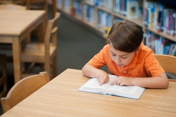 Stock Photo: Student Reading in the Library  #9 -Personal & Commercial Use